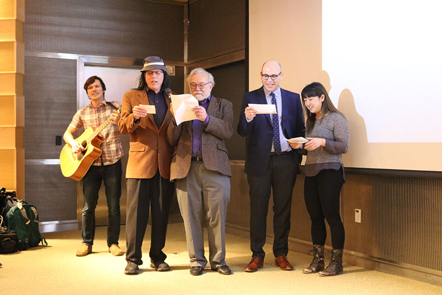 "A group of UC scientists: (left to right) Vladislav Belyy, PhD, UCLA's David Eisenberg, DPhil, AB, Peter Walter, PhD, Oren Rosenberg, MD, PhD, and Seemay Chou, PhD, perform a musical parody about Stroud's research to the melody of Bob Dylan's ""Blowin' in the Wind."""