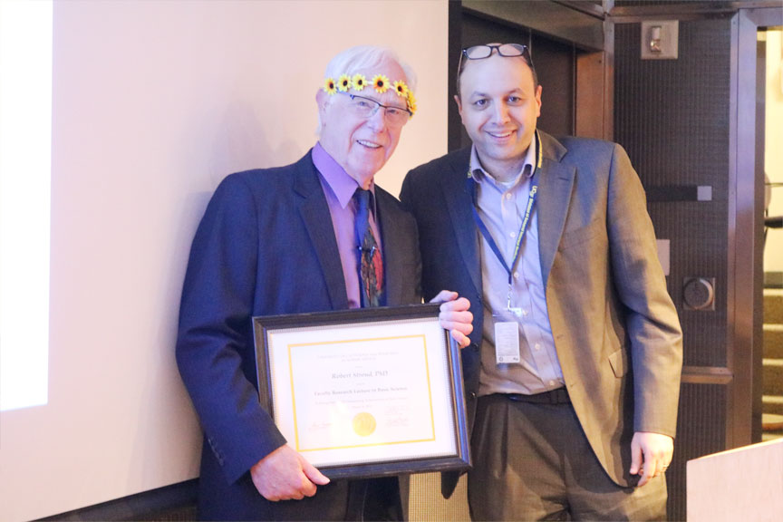 Elad Ziv, MD, (right) member of the Committee on Research presents Stroud with his FRL in basic science award certificate.